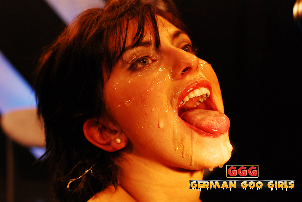 Brunette in a GGG movie covered in cum with mouth open